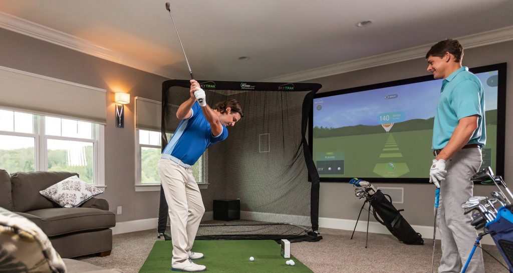 golfers practice with golf simulator