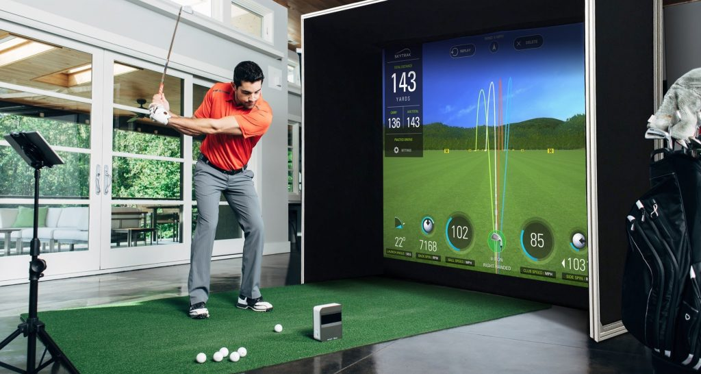 Golfer practices at home.